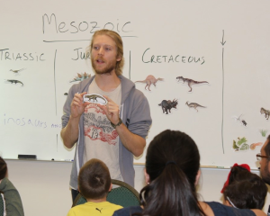"Volunteer Anthony Bailey presenting ""Dinosaurs A to Z"""
