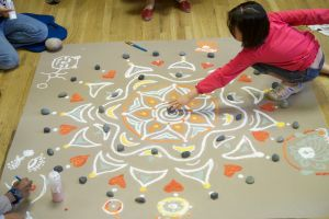 Workshop participants making a mandala.